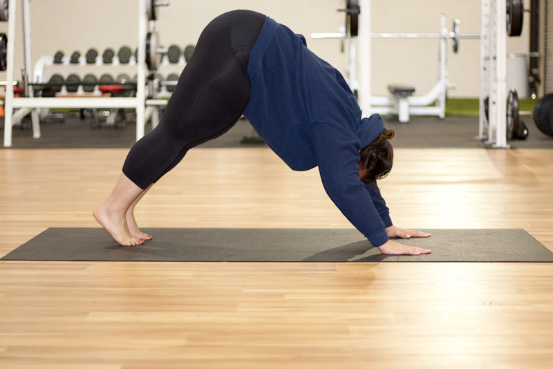 Downward Dog is a yoga position that stretches your shoulders, spine, hamstrings and calves. It is a good stretch for the upper part of your spine between your shoulder blades.
